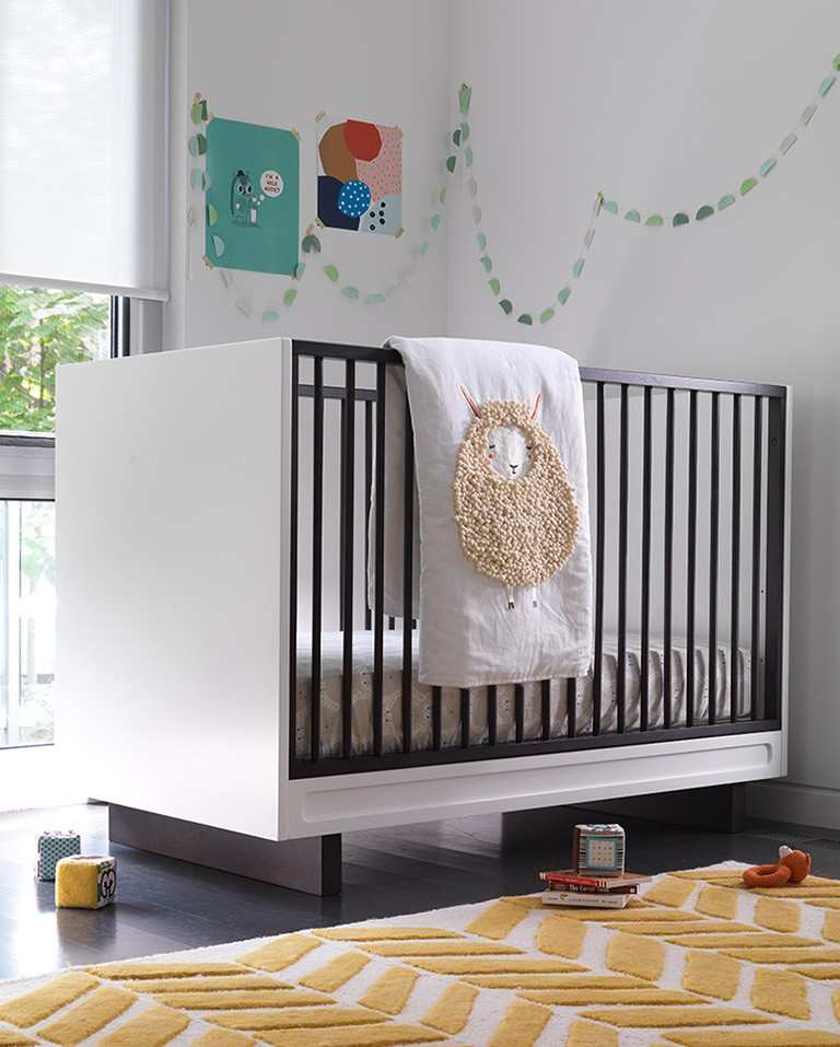 Crib with sheep blanket
