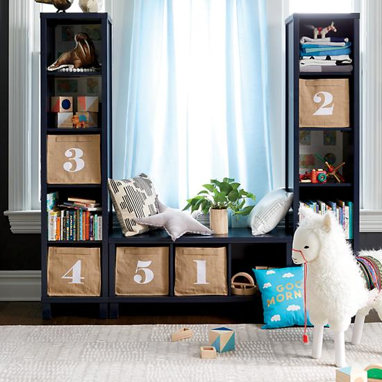 Organizing a toy room with numbered bins