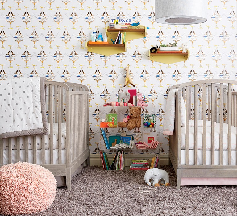 Nursery with two matching cribs.