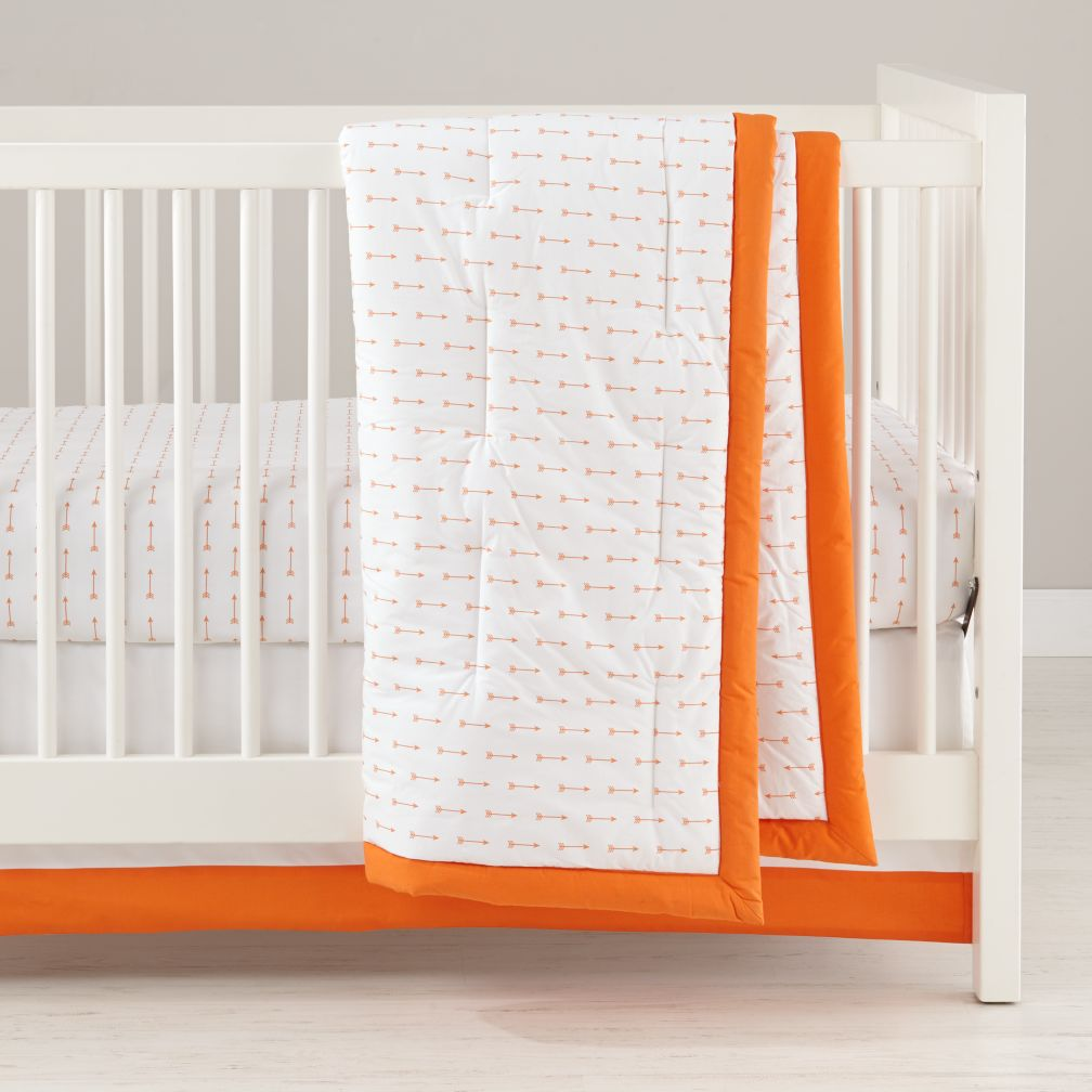 iconic orange arrow baby bedding  the land of nod -