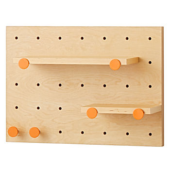 Pegboard and Shelves With 6 Orange Pegs